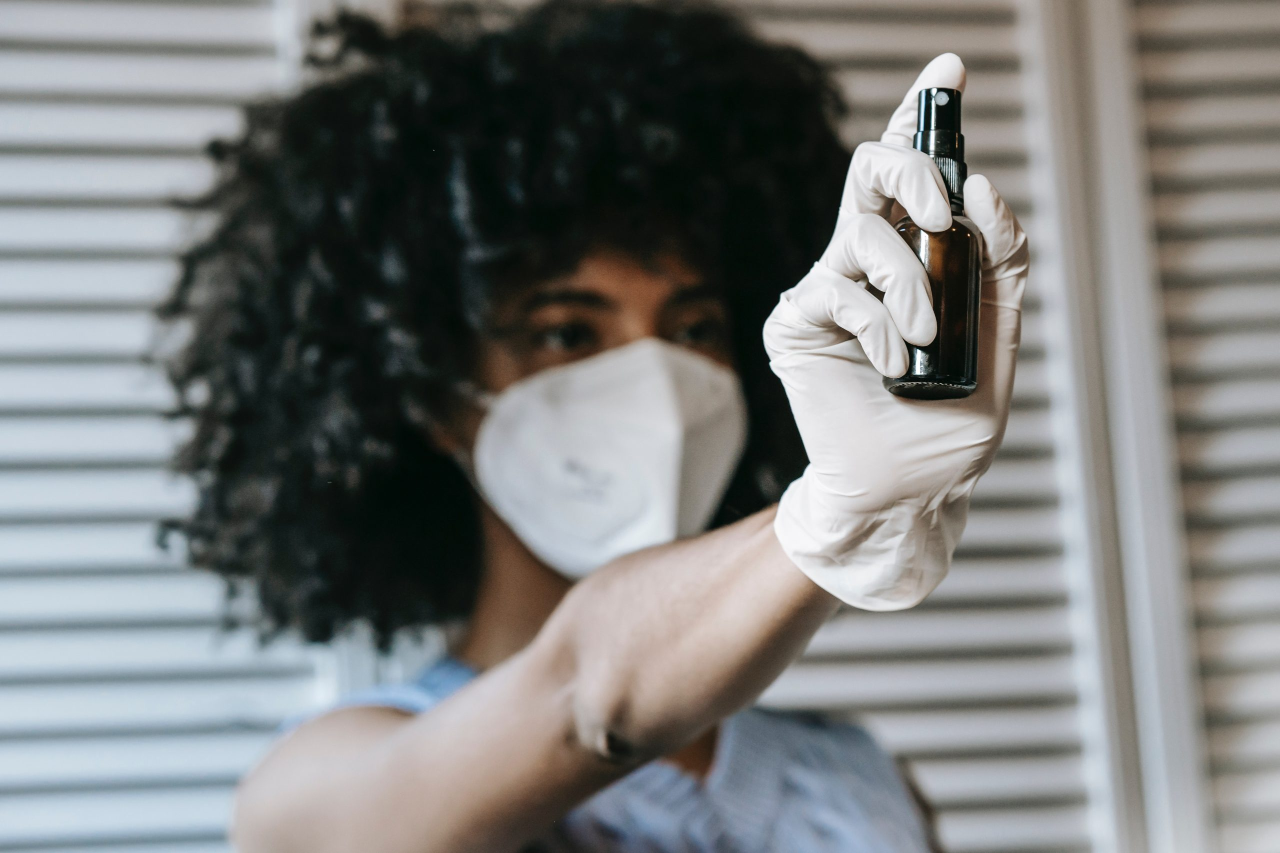 woman with gloves and spray